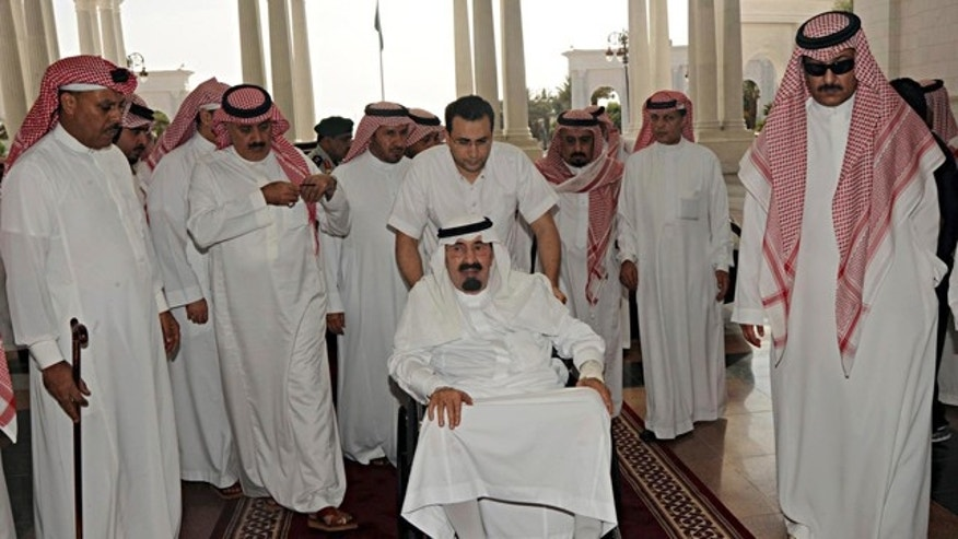 Nov. 19: King Abdullah, center, of Saudi Arabia arrives to his palace in Riyadh, Saudi Arabia. The Saudi Press Agency (SPA) said that King Abdullah entered a hospital on Friday due to complications in the back pain suffered by them and the doctors advised him to rest. (AP/Saudi Press Agency)