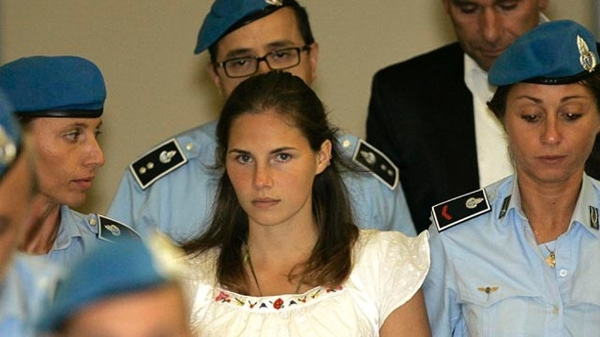 FILE: In this Sept. 16, 2008 photo, U.S. murder suspect Amanda Knox, is escorted by Italian penitentiary police officers from Perugia's court after a hearing in central Italy. After three years in prison, Knox returns to court Nov. 24 for a second chance at freedom.