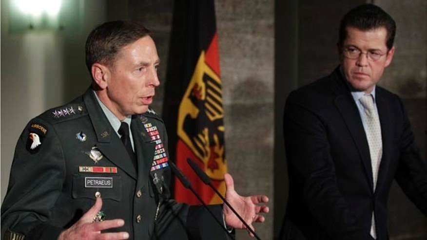 Nov 23: NATO commander in Afghanistan U.S. Gen. David Petraeus, and German Defense Minister Karl-Theodor zu Guttenberg, address the media during a press conference in Berlin, Germany. Petraeus said the military alliance there has an 'anaconda strategy' aimed 'to squeeze the life' out of the Taliban and their allies.