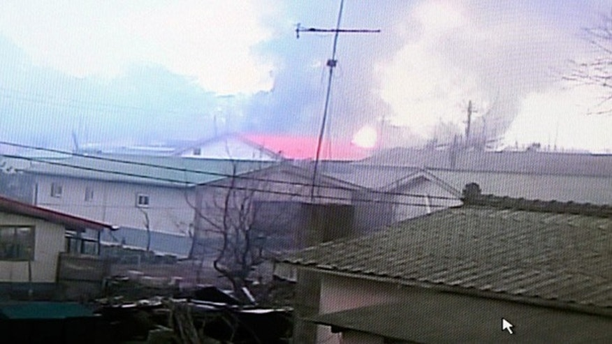 Nov. 23: Homes burn on South Korea's Yeonpyeong island after North Korea fired dozens of rounds of artillery.