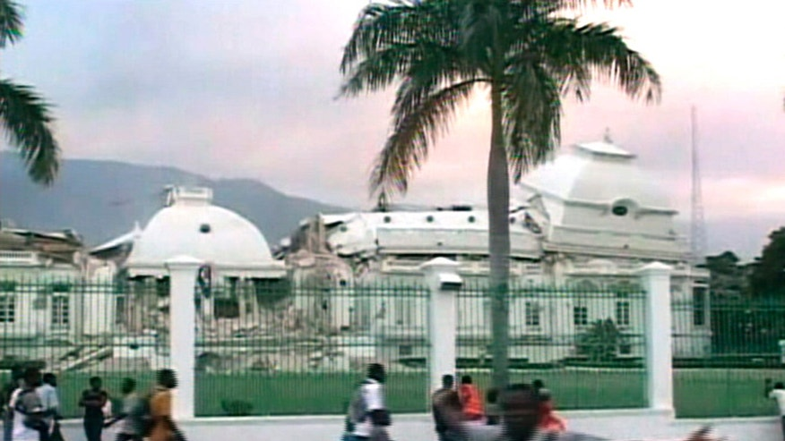 A view of Haiti's Presidential Palace, damaged after an earthquake struck, in Port-au-Prince in this January 12, 2010 video grab. A major earthquake hit impoverished Haiti on Tuesday, toppling buildings in the capital Port-au-Prince, burying residents in rubble and causing many deaths and injuries, witnesses in the city said.   REUTERS/Reuters TV   (HAITI - Tags: DISASTER ENVIRONMENT IMAGES OF THE DAY)