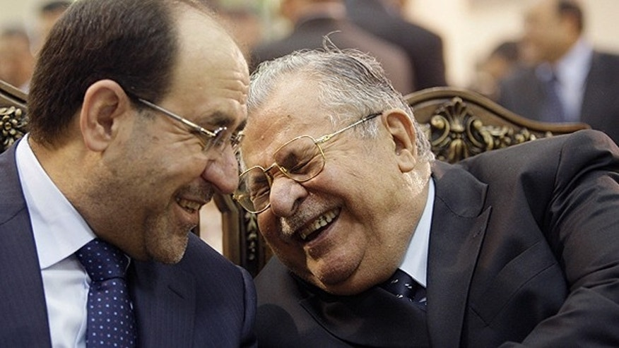 In this June. 27, 2009 file photo, Iraq's Prime Minister Nouri al-Maliki, left, and President Jalal Talabani, right, react, at a ceremony marking the 2003 death of Mohammed Baqir al-Hakim in Baghdad, Iraq.