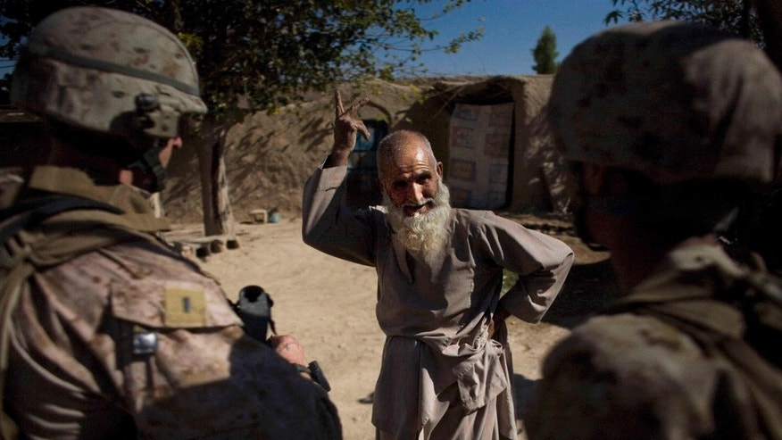 Nov. 10: Marines of India company, 3rd Battalion 5th Marines, First Marine Division, talk to a man in Sangin, Afghanistan. Locals in this southern Afghan valley have accused U.S. Marines of regularly killing civilians. The Marines say these claims are untrue and fueled by insurgent propaganda.