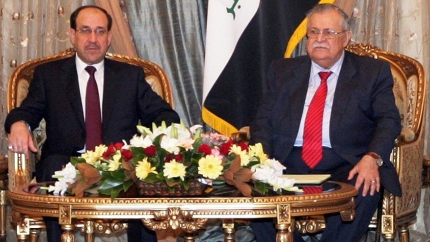 Nov. 25: In this photo released by the Iraqi Government, Iraqi President Jalal Talabani, right, and Iraqi Prime Minister Nouri al-Maliki, left, are seen during a ceremony of asking al-Maliki to form the next government in Baghdad, Iraq.