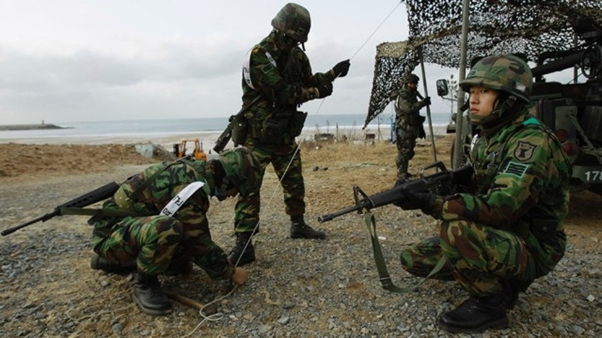 Nov. 28: South Korean soldiers take part in military drills on the beach in Malipo, north western South Korea.