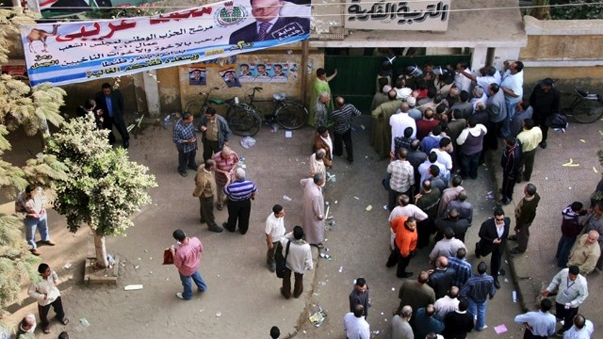 Nov. 28: Egyptians form a line outside a closed polling station in Tanta, north of Cairo, Egypt. Egyptians are choosing a new parliament amid uncertainty over the health of 82-year-old President Hosni Mubarak and widespread frustration over the lack of political reform and economic woes, following a campaign marred by a crackdown on dissent that was seen as an effort by the government to guarantee its powerful grip on authority ahead of a more crucial presidential vote due next year. (AP)