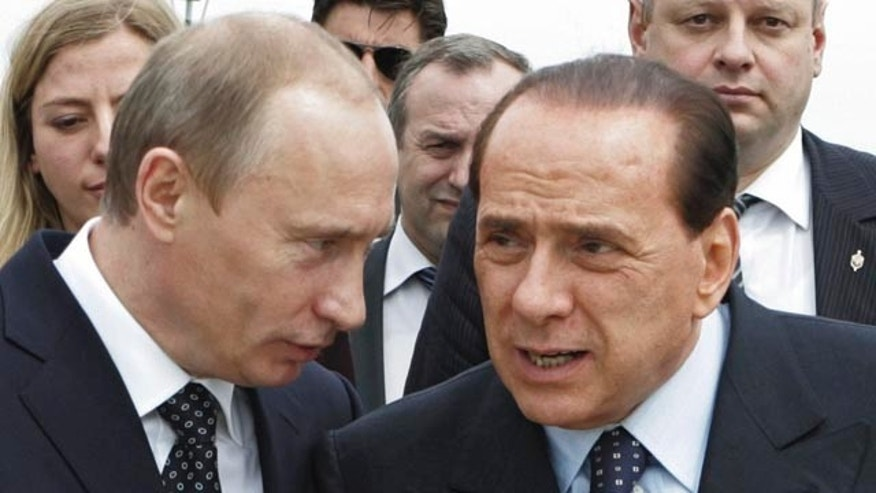 Shown in this file April 18, 2008 photo are Italy's Premier-elect Silvio Berlusconi and Russia's President Vladimir Putin. The classified diplomatic cables released by online whistle-blower WikiLeaks raised questions about Berlusconi and his relationship with Putin. One cable said Berlusconi 'appears increasingly to be the mouthpiece of Putin' in Europe.
