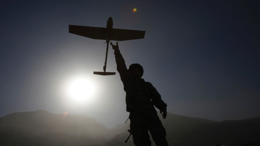 Nov. 29: U.S. Army Spc. Nick Pollock of New Hampshire from First Battalion, 502nd Infantry Regiment, 101st Airborne Division, prepares a SUAV to gain nformation by flying over an area in Panjwai district in Afghanistan's Kandahar province. (AP)