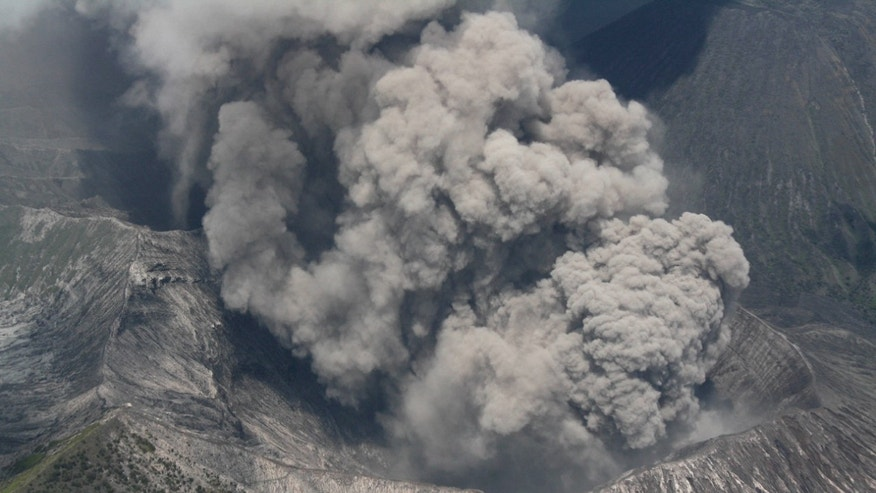 Mount Bromo spews volcanic materials as it erupts in this aerial shot taken from an Indonesian Air Force airplane that flies over Probolinggo, East Java, Indonesia on Monday, Nov. 29, 2010. The smoking volcano on Indonesia's main island has forced the closure of a local airport after it came back to life last week following a yearlong lull.