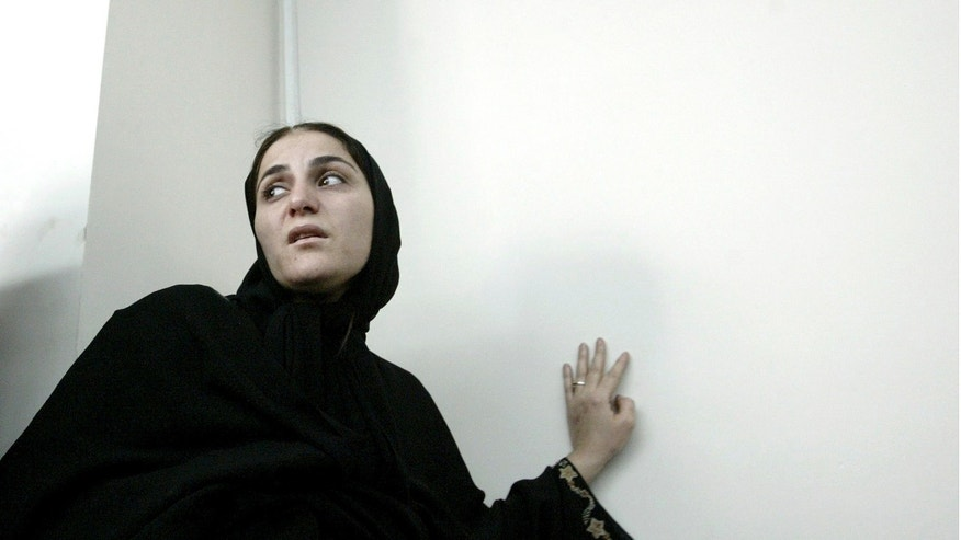 """In this photo taken on June 7, 2004, Shahla Jahed, enters the court room for her trial, in Tehran, Iran. Iran on Wednesday, Dec. 1, 2010, hanged a former soccer player's mistress _ known as a """"temporary wife"""" _ who was convicted of murdering her love rival, the player's wife, the official IRNA news agency reported. Shahla Jahed was hanged at dawn, after spending more than eight years in jail, IRNA said, in a case that has captivated the Iranian public for several years."""