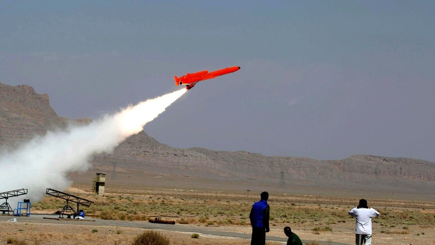 This file photo released on Sunday, Aug. 22, 2010, by the Iranian Defense Ministry, claims to show the launch of the Karrar, or striker in Farsi, the country's first domestically-built, long-range, unmanned bomber aircraft at an undisclosed location. In military maneuvers and air shows, Iran has been proudly touting advances in its air forces and defenses, including radar systems, anti-aircraft batteries and new attack and reconnaissance drones.