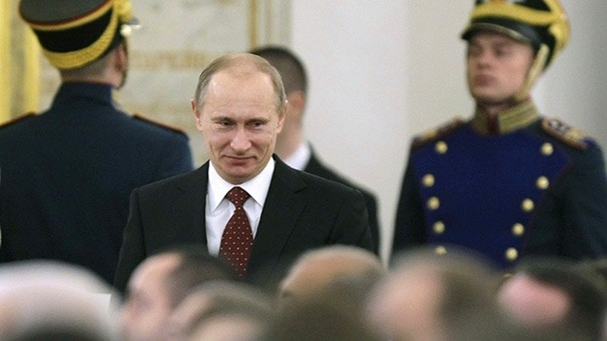 Nov. 30: Russian Prime Minister Vladimir Putin enters the Kremlin's St. George Hall in Moscow.