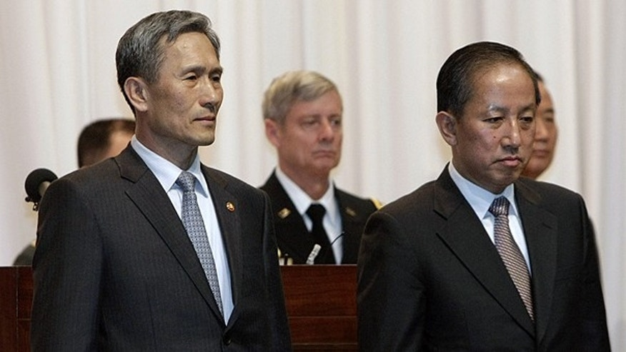 Nov. 4: Incoming Defense Minister Kim Kwan-jin, left, stands with outgoing Defense Minister Kim Tae-young during his inauguration ceremony at the Defense Ministry in Seoul, South Korea.