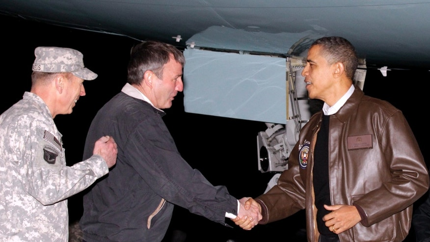 Dec. 3: Obama is greeted by Gen. David Petraeus, left, and US Ambassador to Afghanistan Karl W. Elkenberry, center, after stepping off Air Force One during an unannounced visit to Bagram Air Field in Afghanistan.