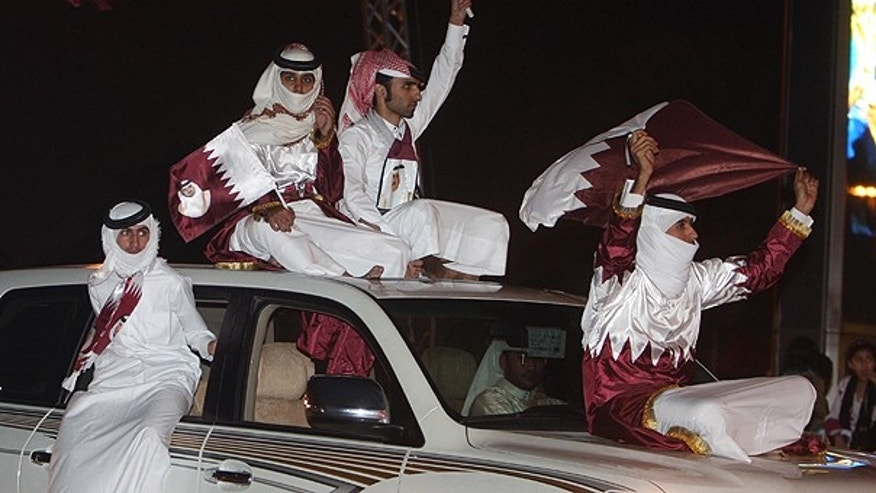 Dec. 3: Qataris wave the national flag as they celebrate in Doha a day after the world football's governing body FIFA announced that the tiny Gulf state will host the 2022 World Cup.