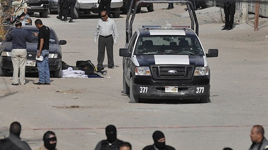 Dec. 4: Municipal and federal police secure the area after gunmen killed four municipal police officers in the northern border city of Ciudad Juarez.
