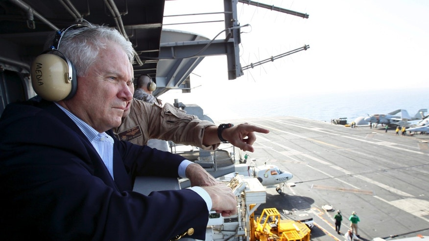 Dec. 6: Defense Secretary Robert Gates watches flight operations from 'Vulture's Row', aboard the USS Abraham Lincoln in the Arabian Sea.