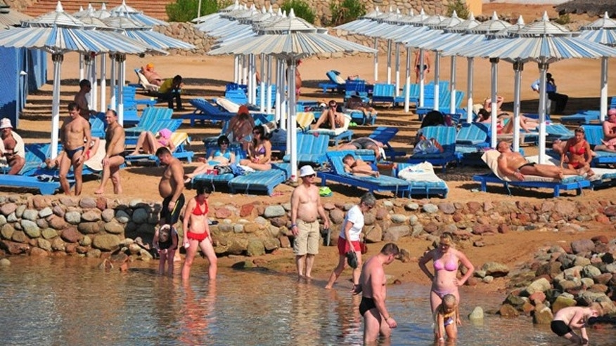 Dec. 6: Tourists sunbathe and stand in the shallow waters at the Egyptian Red Sea resort of Sharm el-Sheikh, Egypt.