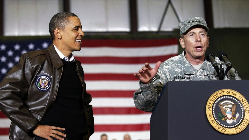 Dec. 3, 2010: U.S. Gen. David Petraeus speaks to the troops during a rally, introducing President Obama for an unannounced visit at Bagram Air Field in Afghanistan.