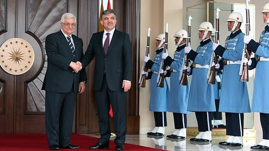 Palestinian leader Mahmoud Abbas, left, and Turkish President Abdullah Gul pose for media cameras before their meeting at the Cankaya Palace in Ankara, Turkey.