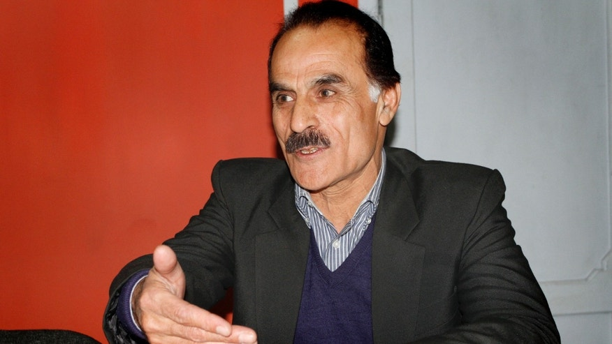 Dec. 9: Abdullatif Qanaat 55, who plays Chief Amin on the Afghan television series Eagle Four, speaks during an interview with The Associated Press in Kabul, Afghanistan.