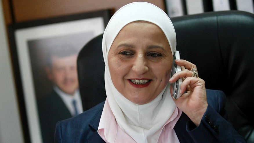 Dec. 9: Newly appointed chief district attorney of the country's capital, judge Ihsan Barakat, 46, speaks on her mobile phone in her office in Amman, Jordan. Barakat is the first woman to hold a top prosecutor's post in the pro-American Arab kingdom.