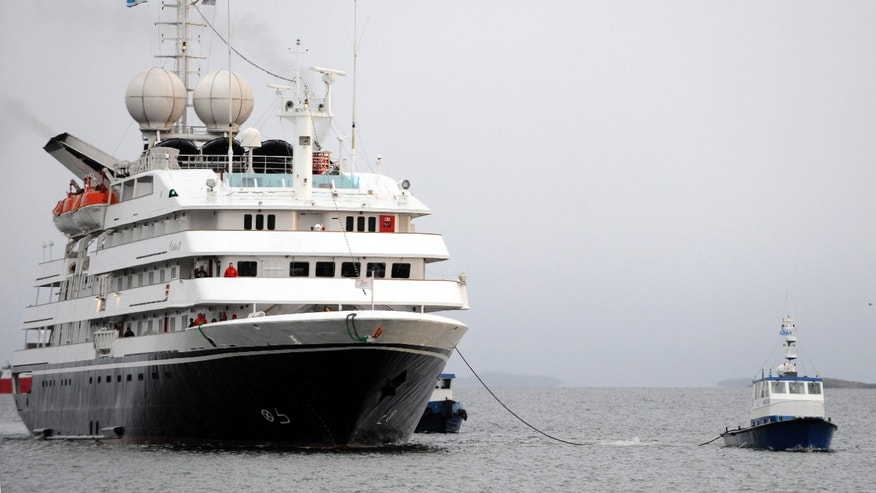 Dec. 9: Greek-owned cruise ship 'Clelia II' is towed to the port of the town of Ushuaia, in Tierra de Fuego, Argentina.
