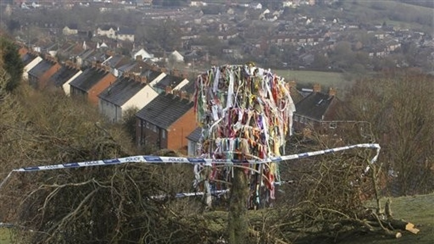 Dec. 10, 2010: Paper decorations hang from the vandalized Glastonbury Holy Thorn Tree  which has been hacked down and reduced to just a stump.