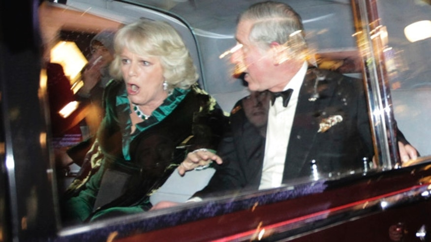 Dec. 9: Britain's Prince Charles and Camilla, Duchess of Cornwall react as their car is attacked in London.