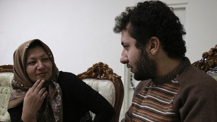 Dec. 4: In this photo released by state-run Press TV, Sakineh Mohammadi Ashtiani, left, sentenced to death by stoning for adultery, meets with her son Sajjad, in an undisclosed location inTabriz, Iran.