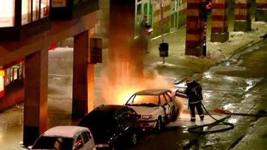 Dec. 11: In this image from video, emergency services attend the scene after a car exploded in the center of Stockholm.