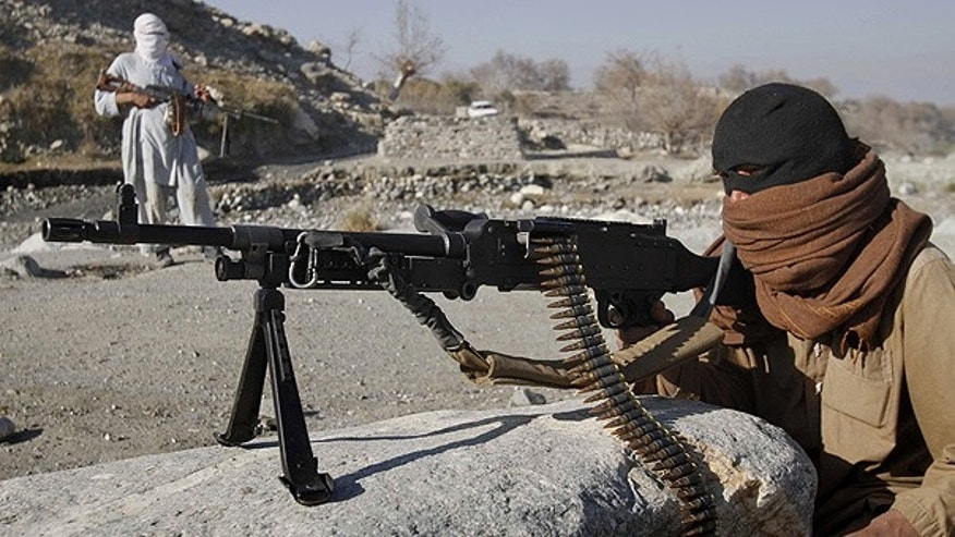 Dec. 13: Taliban fighters man a checkpoint in an undisclosed location east of Kabul, Afghanistan.