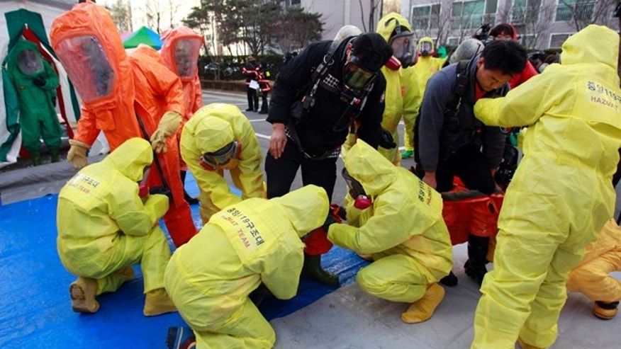 Dec. 15: South Korean hazmat team members wearing anti-chemical suits prepare a civil defense drill from a possible North Korea chemical attack near the border city between the two Koreas in Paju, South Korea.