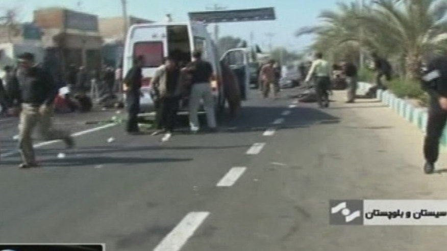 Dec. 15: An ambulance attends the scene of a bomb blast in this image taken from TV, in Chahbahar Iran. The blast killed 39 people near the Pakistan boarder.