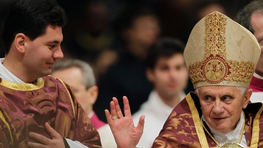 Dec. 16: Pope Benedict XVI blesses the faithful as he arrives in St. Peter's Basilica to celebrate a Vespers prayer at the Vatican.