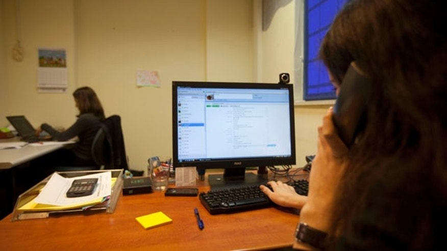 Dec. 16: Israeli project manager Gali Kahane sits in front of a computer in the office of Comply, an Israeli start-up that employs Palestinians, in Hod Hasharon, near Tel Aviv, Israel.