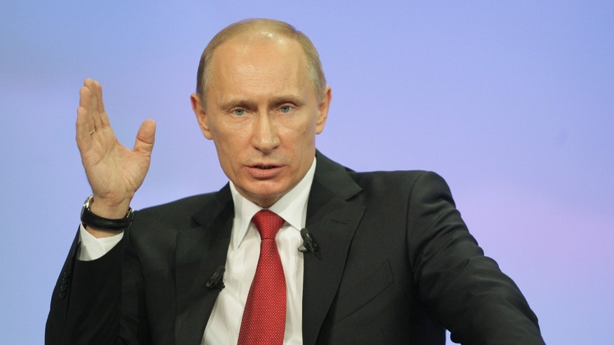 Dec. 16: Russia's Prime Minister Vladimir Putin gestures during a call-in session live broadcast.