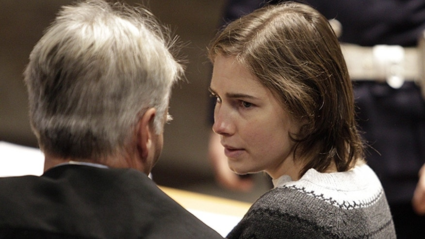 Dec. 11: Amanda Knox, right, talks to one of her lawyers during a hearing in her appeals trial, at Perugia's courthouse, Italy.