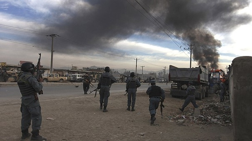 Dec. 19: Afghan soldiers take positions near the site of a gunbattle on the outskirts of Kabul, Afghanistan.