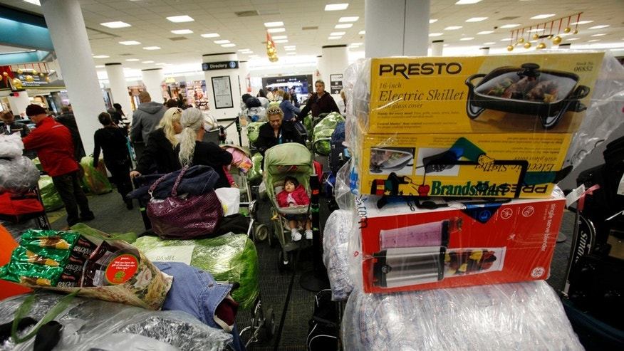In this Dec. 16, 2010 photo, carts are loaded with luggage as passengers wait in line for a flight to Cuba at Miami International Airport in Miami. Thousands of Cuban-Americans are heading to Havana this holiday season carrying everything from electronics and medicine to clothing and toiletries to help relatives back home supplement monthly salaries averaging about $20.  (AP Photo/Lynne Sladky)