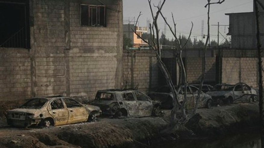 Dec. 19, 2010: Burned out cars and homes are lined up after a pipeline explosion in San Martin Texmelucan, Mexico. A pipeline operated by Mexico's state-owned oil company Petroleos Mexicanos, or PEMEX, exploded when thieves were attempting to steal either gas or oil, killing at least 27 people, authorities said.