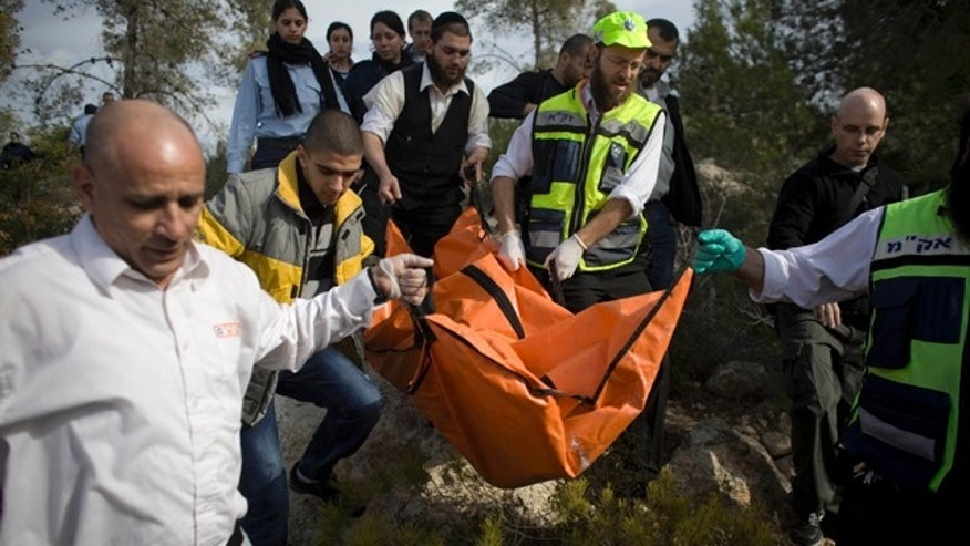 Dec. 19: Israeli rescue workers carry the body of a U.S. tourist after she was found in a wooded area near the village of Mata, outside Jerusalem.