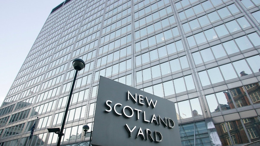 Dec. 20: A view of New Scotland Yard, the headquarters building of the Metropolitan Police, with its sign in London.  On Dec. 20, British police arrested a dozen men suspected of plotting a large-scale terror attack.