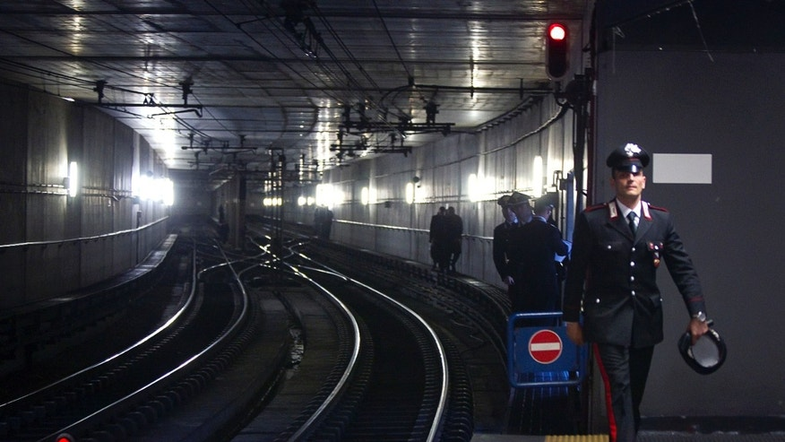 Dec. 21: Police officers patrol the access to the rails at the subway station of Rebibbia after a bomb scare in Rome.