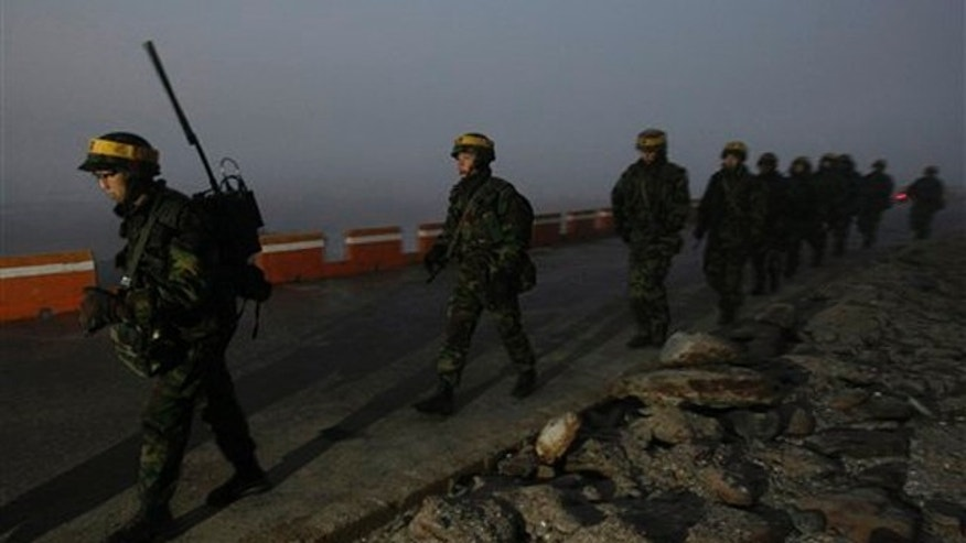 Dec. 19: South Korean Marines patrol along the coast on Yeonpyeong island, South Korea. A U.S. governor visiting North Korea called for it to show maximum restraint to planned South Korean military drills and hoped the U.N. Security Council would deliver the same message strongly as well, his office said.