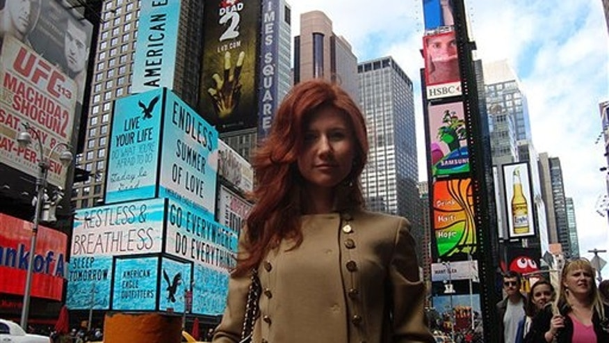 "This undated image taken from the Russian social networking website ""Odnoklassniki"", or Classmates, shows a woman journalists have identified as Anna Chapman, who appeared at a hearing Monday, June 28, 2010 in New York federal court. Chapman, along with 10 others, was arrested on charges of conspiracy to act as an agent of a foreign government without notifying the U.S. attorney general. The caption on Odnoklassniki reads  ""Russia, Moscow. Left 4 dead???"" (AP Photo)"