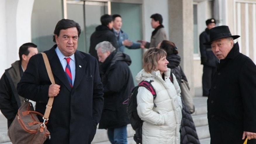 Dec. 16, 2010: In this photo released by China's Xinhua news agency, U.S. New Mexico Gov. Bill Richardson arrives in Pyongyang, North Korea.