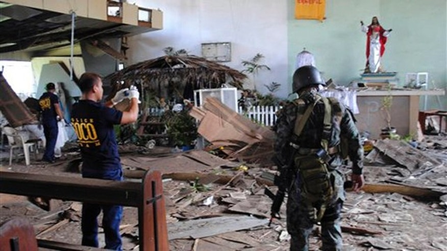 Dec. 25, 2010: Philippine National Police investigators inspect the damage of the Sacred Heart Catholic chapel following an explosion during a Christmas Day mass at the volatile island of Jolo, Sulu province in southern Philippines.