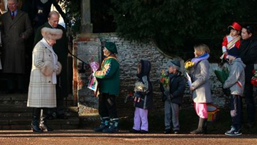 Dec. 25, 2010: Britain's Queen Elizabeth II receives flowers from children as she leaves after attending the British royal family's traditional Christmas Day church service in Sandringham, England.