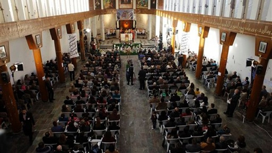 Dec. 25, 2010: Iraqi Christians attend a Mass at Our Lady of Salvation church in Baghdad, Iraq. Iraqi Christians are marking a somber Christmas in the face of repeated violence by militants intent on driving their beleaguered community from Iraq.
